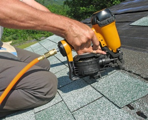 RooferNailGun300x244. 300x244 Re roofing Your Halifax Home Before You Sell